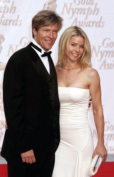 Jack Wagner poses with Kristina Wagner as he arrives to attend the Gold Nymph awards ceremony at the 44th Monte-Carlo Television Festival, Monte Carlo, Monaco on July 3, 2004