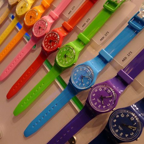 multi-colored Swatch Watches, good for nursing.