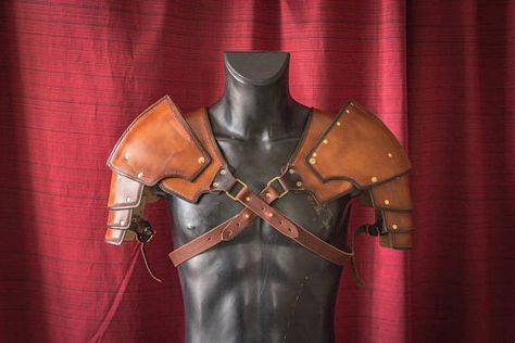 A wonderful shoulder armor made with great attention to details. Suitable for most costumes for LARP games, or can be worn without any costume if you want to look like a barbarian berserk. The armor is made of thick leather, does not crumple, keeps its shape and at the same time is made in