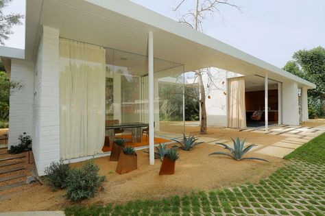 In the Hollywood Hills area of Los Angeles, California, a small one bedroom home, whose design echoes mid-20th Century horizontal lines, was added to an existing property.