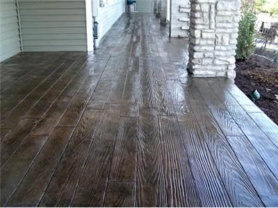 Concrete that's been stamped and stained to look like hardwood.