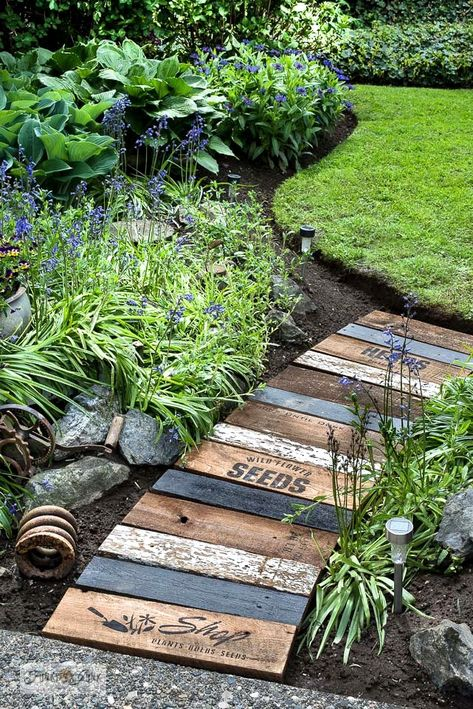 Learn how to build this easy and beautiful garden-themed reclaimed wood walkway with scrap wood and stencils! Easy to customize! Garden Paths, Garden Art, Garden Types, Walkway Garden, Garden Ideas, Pallet Garden Projects, Diy Projects, Wood Garden Edging, Garden Stepping Stones