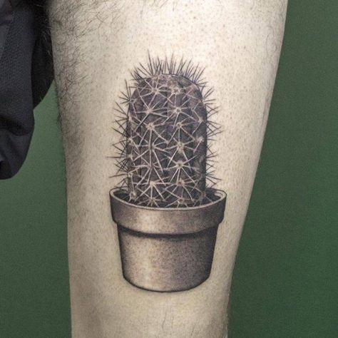 Fine line cactus tattoo on the left thigh. Tattoo artist: Sven...