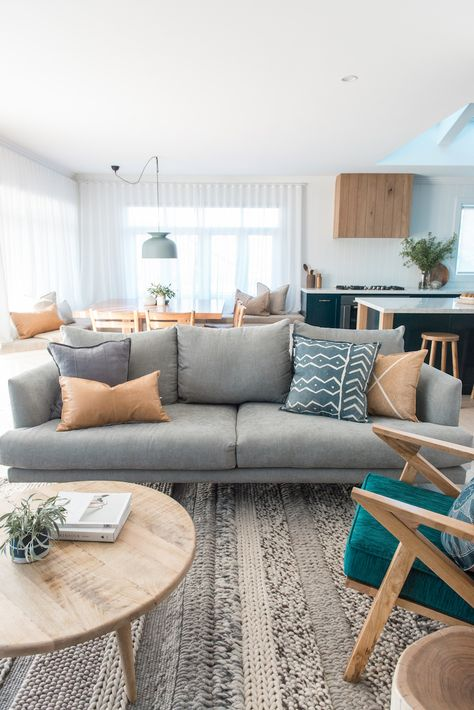 Most incredible rug with mix of weaving techniques. Love the tan and timber accents in this contemporary Australian living room