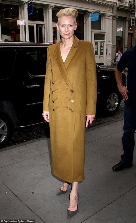 Tilda Swinton steps out in white dress and champagne coat