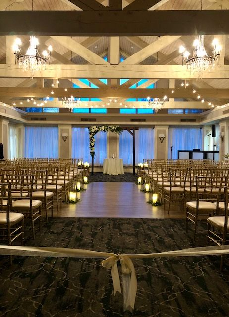 #winterwedding #indoorceremony #exposedbeams #weddingdecorideas #winterweddingideas #ivory #weddingarchdecor #ceremonyideas #weddingceremonydecor #floristideas #weddingflowers #bistrolights #rustic #rusticwedding #blueheronweddings #ronjaworskiweddings #njweddings #weddingvenue #ballroom #weddingballroom #venueideas #winterweddingvenue #rusticwinterwedding #coastawedding #christmaswedding #christmasweddingideas #evening #eveningceremony #chiavarichairs #gold #aisledecor #chandeliers