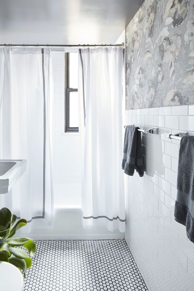 Subway Tile Halfway Up The Wall With Floral Wallpaper Above White Penny Tile With Dark Grout Tub Insert Penny Tiles Bathroom Powder Room Design Tub Insert