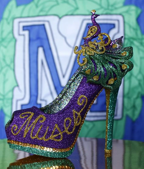An all-female Mardi Gras parade group known as the Krewe of Muses creates hand decorated s...