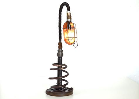 Reclaimed Industrial Lamp. Made from pipe, cage light, spring flex pipe, metal coil, and an old brake rotor. Handcrafted by Dennis John Industrial  Rustic, Unique, Reclaimed, Salvage, Steam Punk, Man Cave, Father's Day Gift, Guy Gift