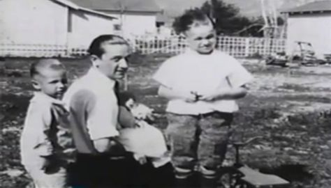 Here is young Bill with his dad and younger brothers.