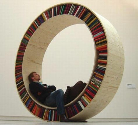Step in and roll over the 'Circular Walking Bookshelf' to access the books | Designbuzz : Design ideas and concepts