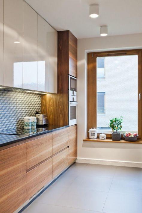 weiße Küchenschrankfronten, schwarze Arbeitsplatte und Holz - arbeitsplatte holz küche