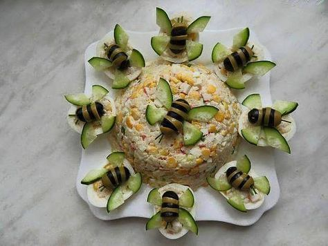 Sweet Home: Fun salads. Bees made with black and green olives and cucumber wings, appears to be egg salad, bees sitting on halved hard boiled eggs.