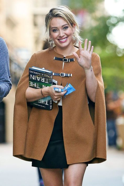Zara camel wool cape/ coat with short black dress.