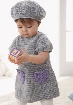 Sweet dress with accent heart pockets and matching beret for ages 6 to 18 months. Crocheted in Patons Beehive Baby Sport - free pattern at Patons