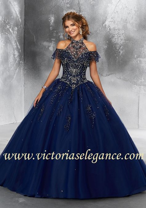 e3ec4152ffd This Mori Lee Vizcaya 89183 ballgown features an illusion high neckline and  cold-shoulder sleeves