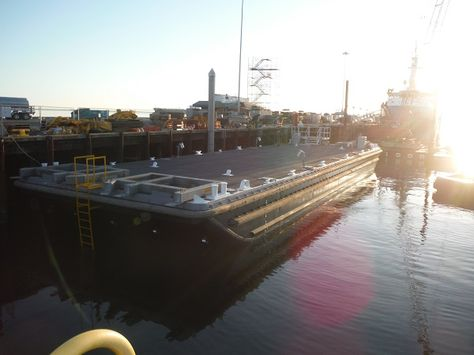 USN YC-1636 , a 110' barge was hauled out at Pacific Northwest Shipyard for an extensive dry dock period. Platypus Marine Workers removed wildlife growth, rubber fenders and expired zinc anodes to prepare for exterior sandblasting. During the same time frame, the Naval Barge underwent ultrasonic testing to measure the thickness of the plating.