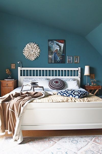 White bed and blue walls make this bedroom so calming and peaceful