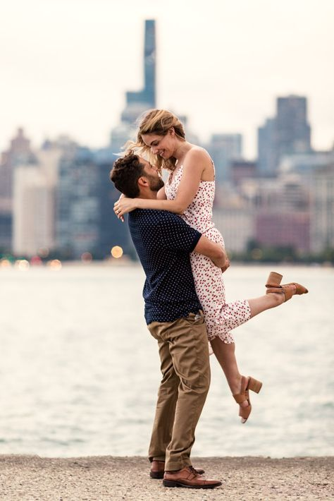 Romantic Chicago engagement photo at North Avenue Beach with skyline