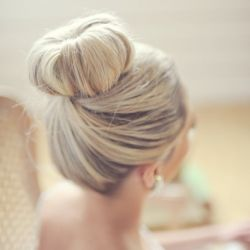 Gorgeous high bun for a wedding, via Style Me Pretty.