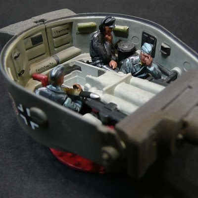 Removing the rear deck reveals the tank's petrol engine