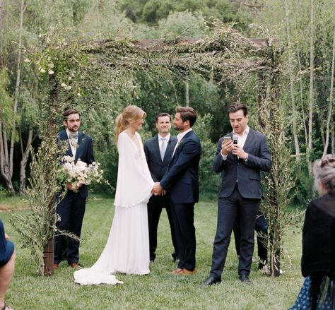This earthy chuppa is made with olive branches and folliage are perfect for a boho forest wedding! Click through for more rustic wedding ideas. #rusticwedding #weddingarch #weddingceremony #bohowedding #forestwedding #weddingceremonyarch