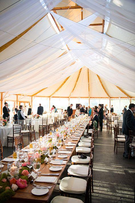 A sailcloth reception tent with draped fabric | @snapgirls | Brides.com