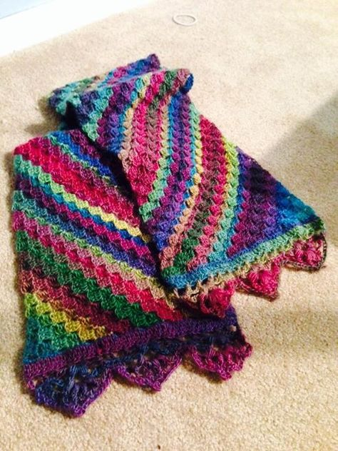 "From fan Kristi Pavlick Hasleton‎: ""Made a corner to corner scarf with unforgettable yarn in stain glass. Beautiful colors! And my friend loved it!"""