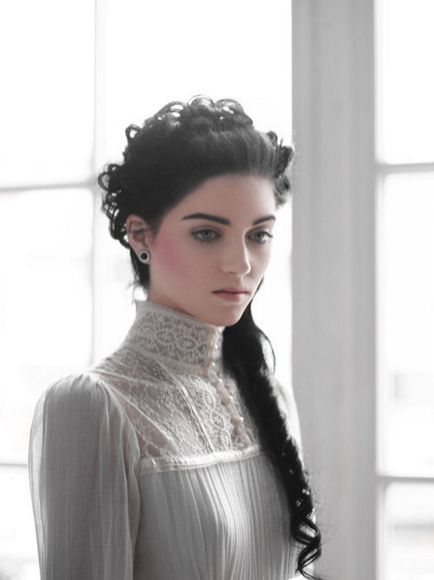 The model, dress.This is an example of the Edwardian collar style. The Edwardian collar style is the most modest because it covers the neck and below.