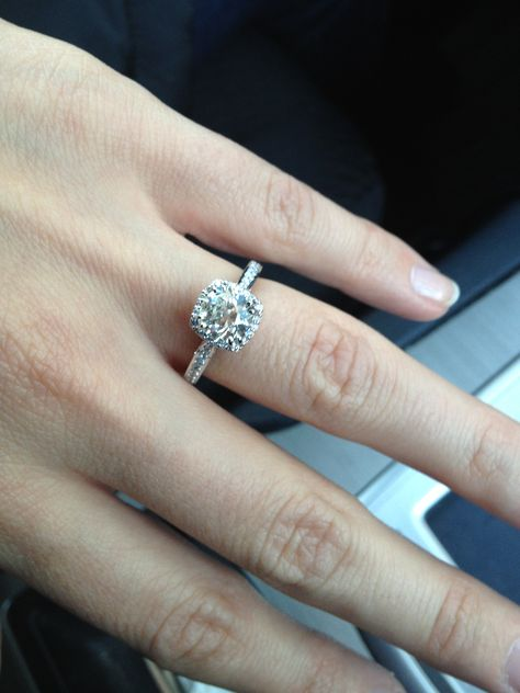 round center stone with cushion pave halo and pave band