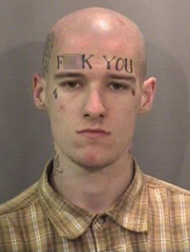 Nothing like a bleeping tattoo to get you busted by law enforcement. Patrick Francis Brooks' polite mug shot has gone viral due to the 21-year-old's hard to miss message to police ... and everyone he comes into contact with