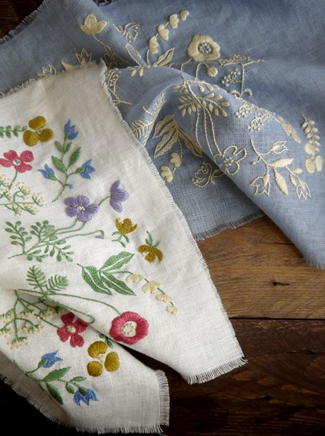 Embroidered flowers of the field on linen.