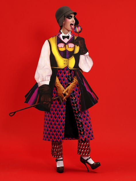 Coat, pants, shirt and shoes by Prada. Hat and gloves by Maison Martin Margiela. Socks by Falke.