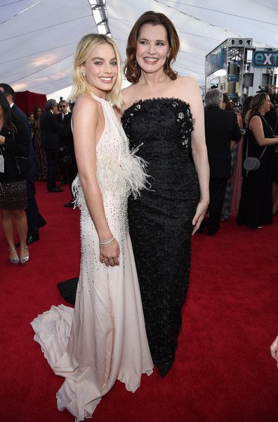 Actors Margot Robbie (L) and Gina Davis attend the 24th Annual Screen ActorsGuild Awards.