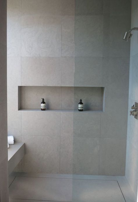 neutral matte grey large scale tiles inspired by concrete for a modern bathroom