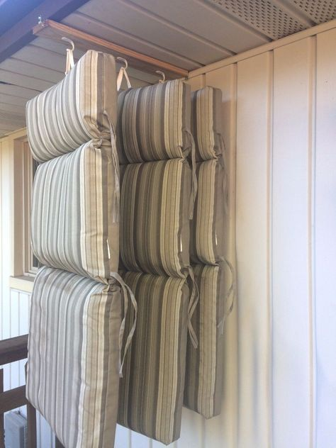 This man came up with a clever storage idea for his porch cushions! See how to do it with hooks from Walmart:
