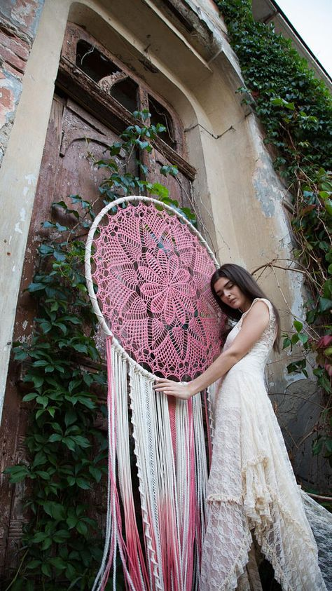 This giant pink dreamcatcher wall hanging is love from the first sight. Its intricate pattern of the pink crochet doily in the center circle and carefully chosen delicate lace, ribbons and yarn of different texture and shades of ivory and cream with pink ombre at the bottom will