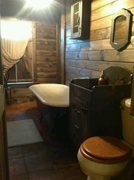 primitive bathrooms -love the pallets on the wall. gorgeous and cheap to do