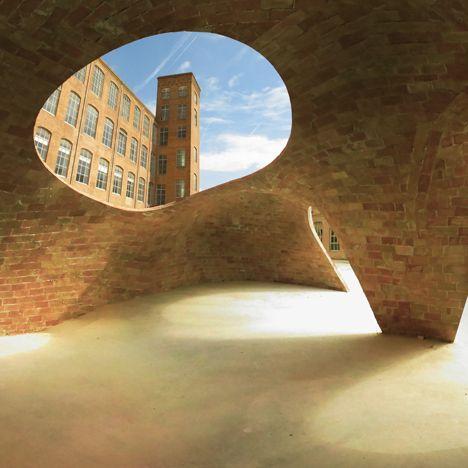 vaulted brick pavilionin a Barcelona courtyard