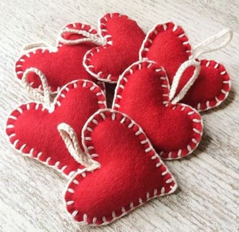 Look Over This Handmade red felt heart with contrasting white blanket stitch, hung on plaited cotton. Perfect for creating a traditional, vintage or Scandi Christmas style. The post Handmade red fel . Handmade Christmas Decorations, Felt Christmas Ornaments, Heart Decorations, Valentine Decorations, Diy Ornaments, Handmade Christmas Gifts, Beaded Ornaments, Glass Ornaments, Valentine Day Crafts