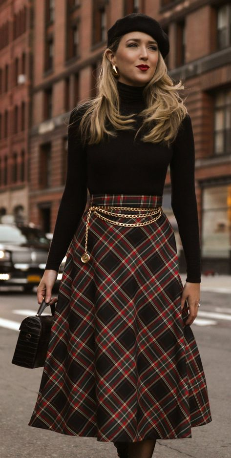 For those days when a power look isn't necessary (or maybe just hasn't come back from the dry cleaner yet) Black ribbed turtleneck sweater, high waisted plaid a line skirt, black leather lace up mid calf boots, gold triple chain vintage belt, black velv