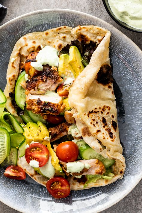 Juicy chicken shawarma marinated in spiced yogurt then grilled is a delicious dinner served wrapped in easy flatbread with crunchy vegetables. #shawarma #chickenrecipe