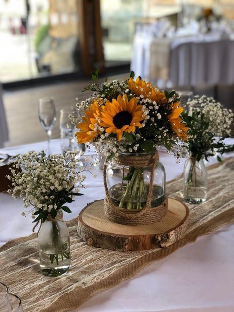 We provided these centrepieces for a sun flower wedding last year. Rustic Sunflower Centerpieces, Sunflower Wedding Decorations, Sunflower Party, Rose Centerpieces, Rustic Wedding Flowers, Rustic Wedding Centerpieces, Centrepieces, Sunflowers And Roses, Wedding Cakes With Sunflowers