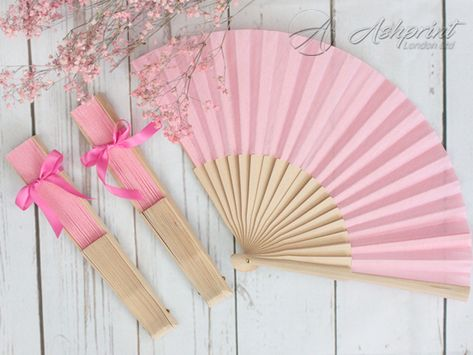 Cool off with a gentle breeze using a handheld fan. Place on chairs at the wedding ceremony or at table place settings at the reception. Perfect wedding favour that can be used time and time again. #handfan #woodenhandfan #accessories #handcrafted #fabric #fabrichandfan #fabricfan #fabrichandfan #favors #gifts #weddingfavor #summerm #weddingideas #weddingfan #summerwedding #guestfavors #weddingfavourideas #weddinggifts #rusticwedding #bohowedding #weddingseason #london #wembley #london