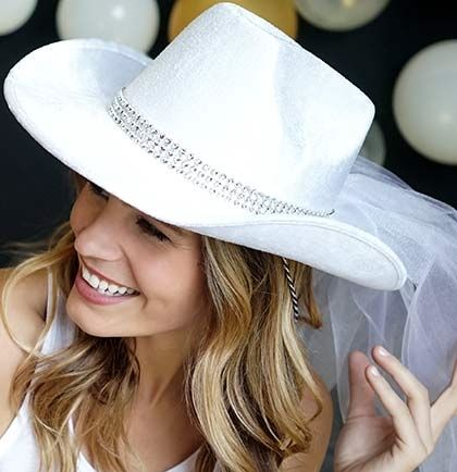 The Bride Will Turn Heads In This White Western Party Hat The Hat Features A Bling Band And Veil Ma Cowgirl Boots Wedding Cowgirl Bachelorette Cowgirl Wedding