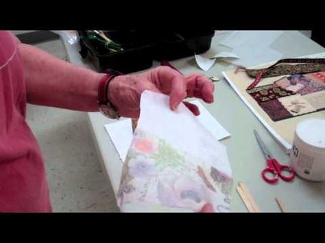 Art League instructor Rosemary Luckett shows her collage class how to use different kinds of glues.
