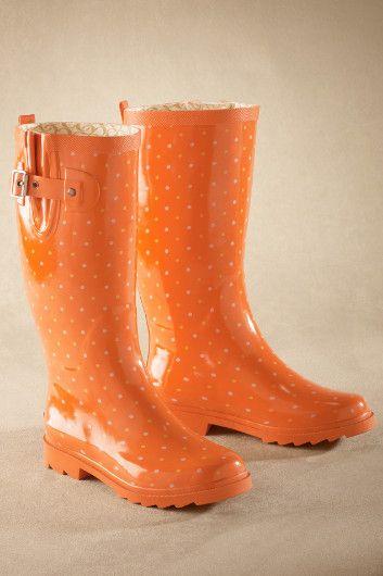 Orange polka dot rain boots -