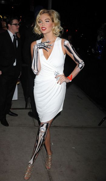 Great Halloween Cocktail Party costume - though you have to be rather thin to really pull it off. Kate Upton outside Heidi Klum's Halloween Party