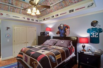 Bedroom for the teen football player! Ii like how the ceiling makes the bed feel like it is on the inside of a stadium.
