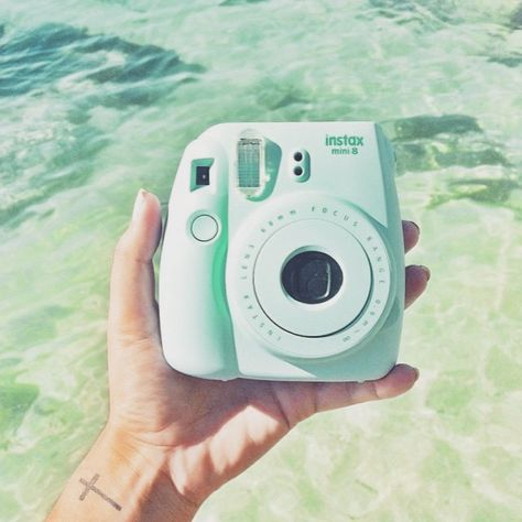 ✖ Mint green polaroid camera ✖ I want to take one picture a day while Im gone on my 9 month internship in Uganda